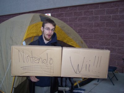 Virtuoso holding up a Nintendo Wii box sign